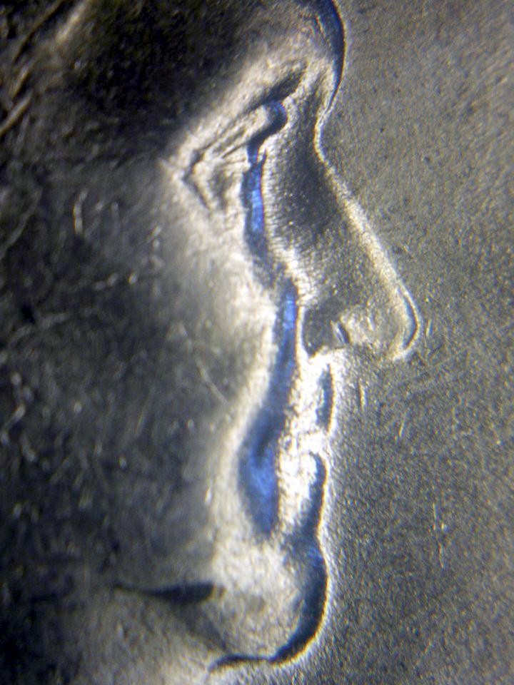 http://koinpro.tripod.com/CPG5II/1948_50c_Booger_Clash_BrettParrish_CoinAndPhoto.jpg